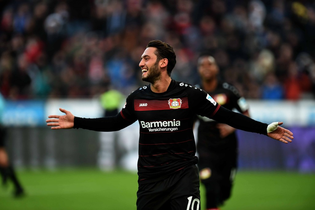 Leverkusen's midfielder Hakan Calhanoglu celebrates during the German first division Bundesliga football match of Bayer Leverkusen vs Hertha BSC Berlin in Leverkusen, western Germany, on January 22, 2017. / AFP / PATRIK STOLLARZ / RESTRICTIONS: DURING MATCH TIME: DFL RULES TO LIMIT THE ONLINE USAGE TO 15 PICTURES PER MATCH AND FORBID IMAGE SEQUENCES TO SIMULATE VIDEO. == RESTRICTED TO EDITORIAL USE == FOR FURTHER QUERIES PLEASE CONTACT DFL DIRECTLY AT + 49 69 650050 (Photo credit should read PATRIK STOLLARZ/AFP/Getty Images)