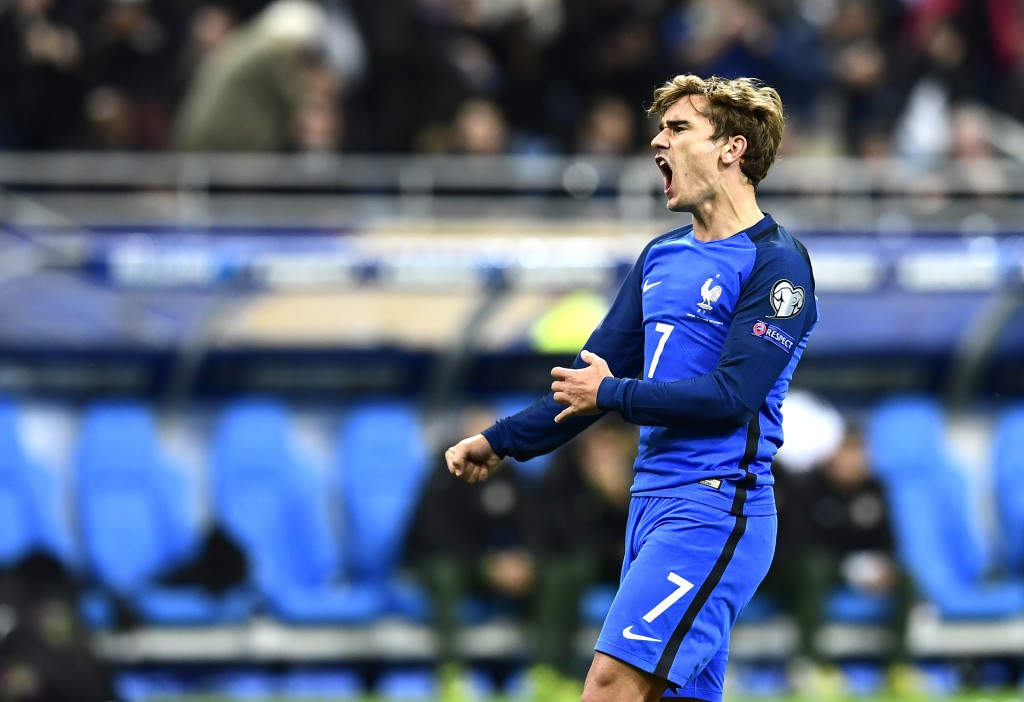 France's forward Antoine Griezmann celebrates after he scored his team's third goal during the FIFA World Cup 2018 qualifying football match France vs Bulgaria on October 7, 2016 at the Stade de France stadium in Saint-Denis, north of Paris. / AFP / MIGUEL MEDINA (Photo credit should read MIGUEL MEDINA/AFP/Getty Images)