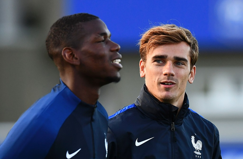 France's forward Antoine Griezmann (R) speaks to France's midfielder Paul Pogba during a training session in Clairefontaine-en-Yvelines near Paris on October 4, 2016 ahead of the 2018 FIFA World Cup football matches against Bulgaria on October 7 and the Netherlands on October 10. / AFP / FRANCK FIFE (Photo credit should read FRANCK FIFE/AFP/Getty Images)