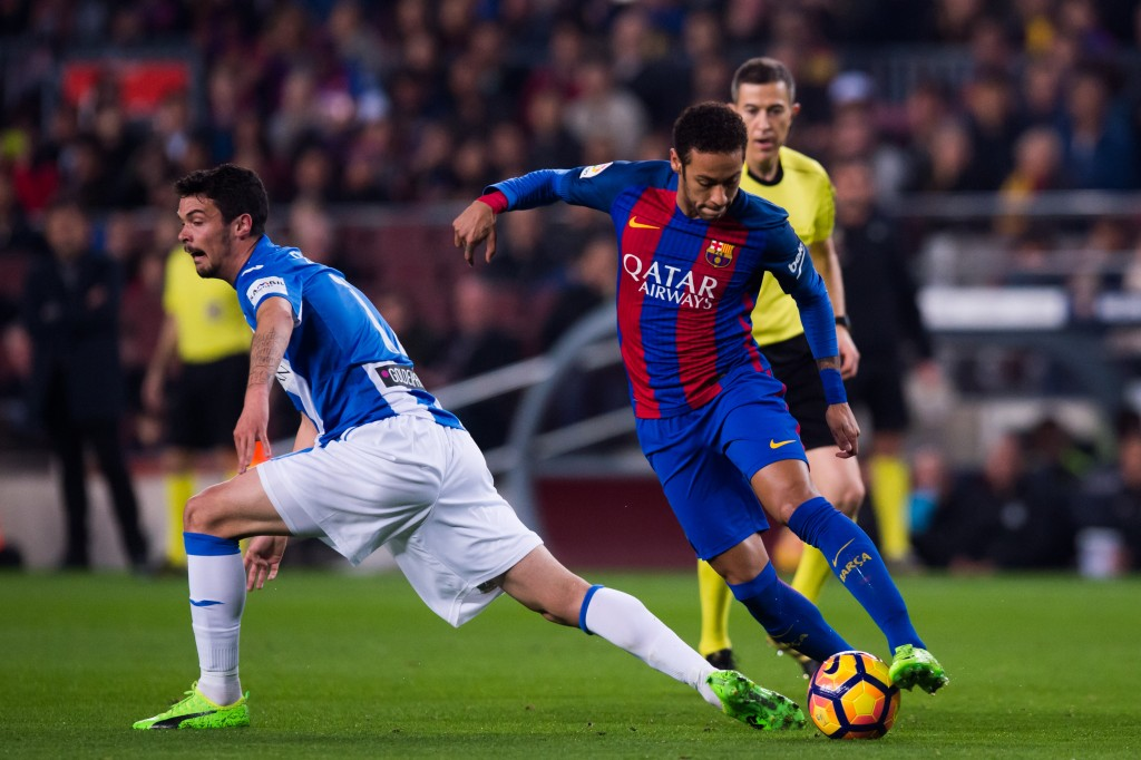 BARCELONA, SPAIN - FEBRUARY 19: Neymar Santos Jr of FC Barcelona dribbles past Erik Moran of CD Leganes during the La Liga match between FC Barcelona and CD Leganes at Camp Nou stadium on February 19, 2017 in Barcelona, Spain. (Photo by Alex Caparros/Getty Images)