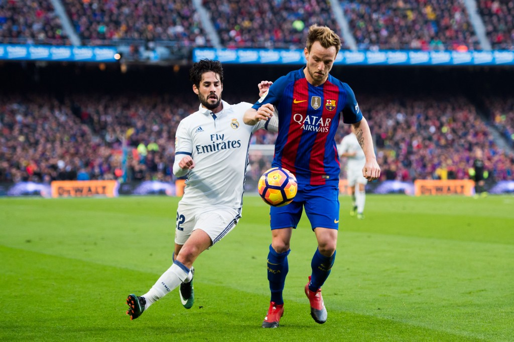 Could Isco and Rakitic be swapping shirts at the end of the season? (Photo courtesy - Alex Caparros/Getty Images)