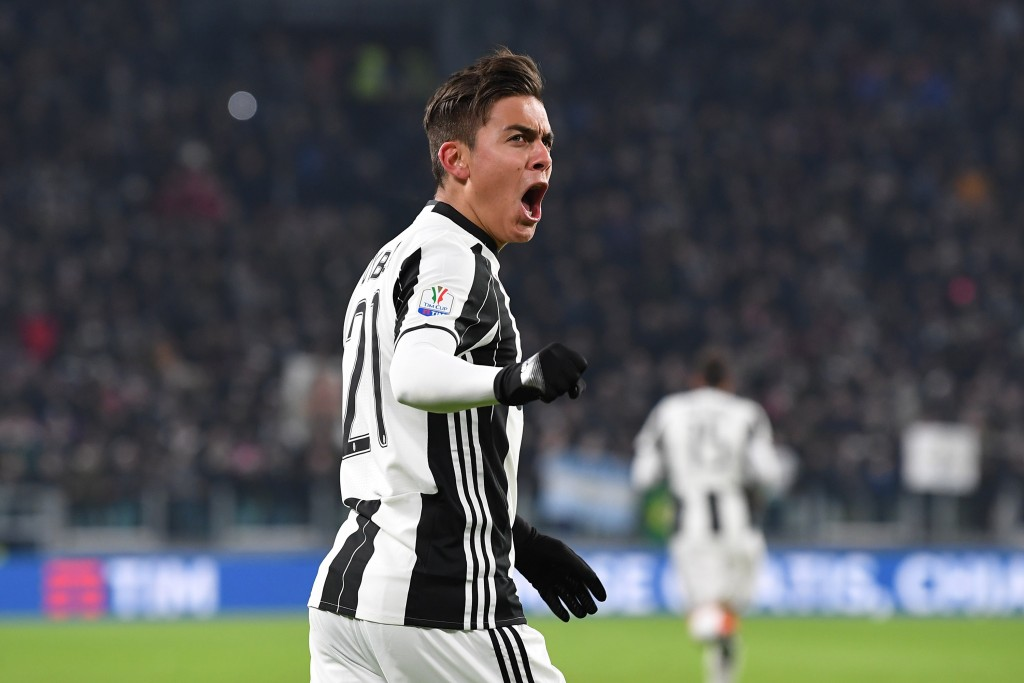 TURIN, ITALY - JANUARY 25: Paulo Dybala of Juventus FC celebrates after scoring the opening goal during the TIM Cup match between Juventus FC and AC Milan at Juventus Stadium on January 25, 2017 in Turin, Italy. (Photo by Valerio Pennicino/Getty Images)