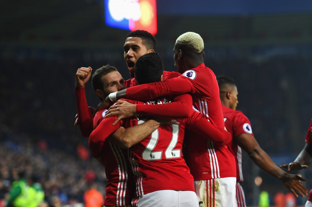 LEICESTER, ENGLAND - FEBRUARY 05: Juan Mata of Manchester United (L) celebrates with team mates as he scores their third goal during the Premier League match between Leicester City and Manchester United at The King Power Stadium on February 5, 2017 in Leicester, England. (Photo by Shaun Botterill/Getty Images)