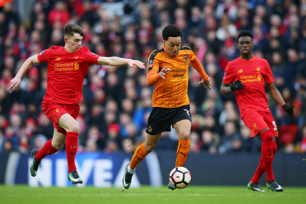 LIVERPOOL, ENGLAND - JANUARY 28: Helder Costa of Wolverhampton Wanderers and Ben Woodburn of Liverpool in action during the Emirates FA Cup Fourth Round match between Liverpool and Wolverhampton Wanderers at Anfield on January 28, 2017 in Liverpool, England. (Photo by Alex Livesey/Getty Images)