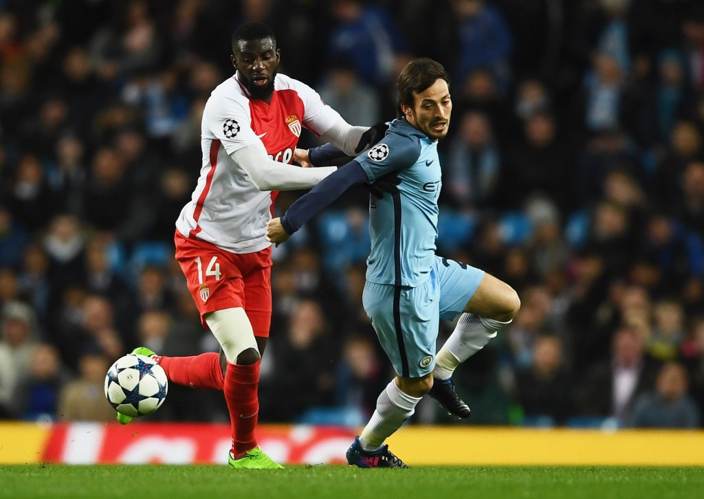 MANCHESTER, ENGLAND - FEBRUARY 21: David Silva of Manchester City battles with Tiemoue Bakayoko of AS Monaco during the UEFA Champions League Round of 16 first leg match between Manchester City FC and AS Monaco at Etihad Stadium on February 21, 2017 in Manchester, United Kingdom. (Photo by Laurence Griffiths/Getty Images)