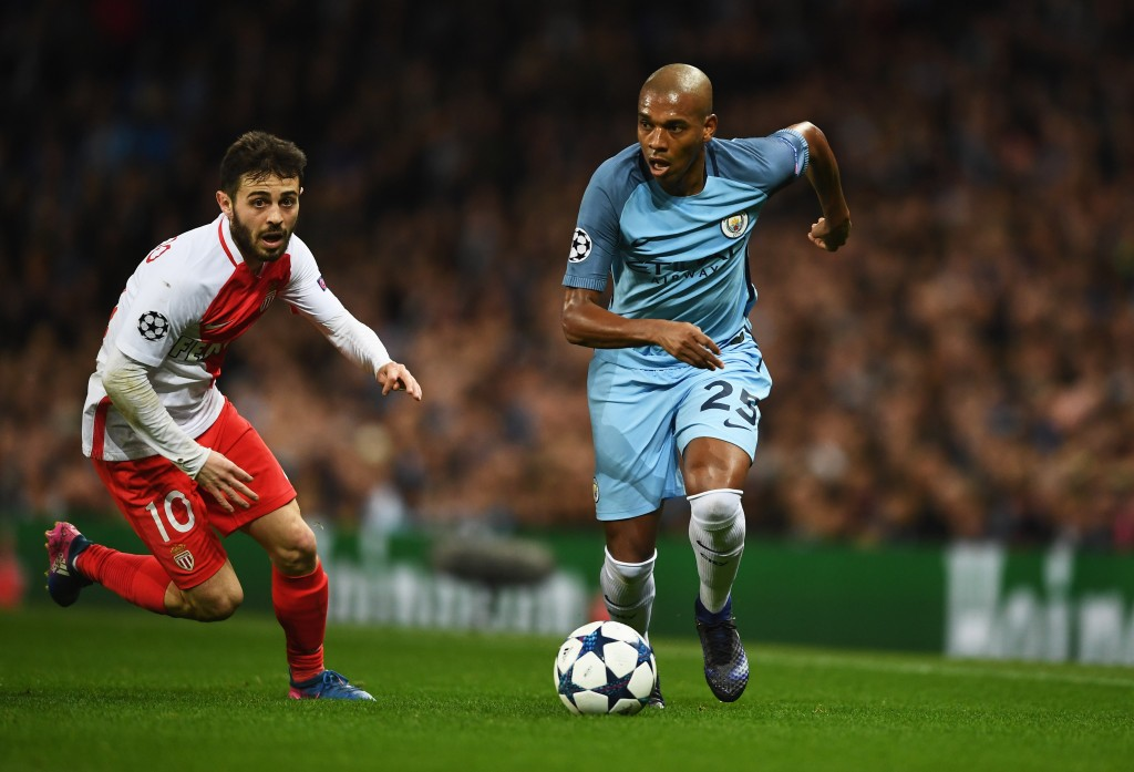 MANCHESTER, ENGLAND - FEBRUARY 21: Fernandinho of Manchester City takes on Bernardo Silva of AS Monaco during the UEFA Champions League Round of 16 first leg match between Manchester City FC and AS Monaco at Etihad Stadium on February 21, 2017 in Manchester, United Kingdom. (Photo by Laurence Griffiths/Getty Images)