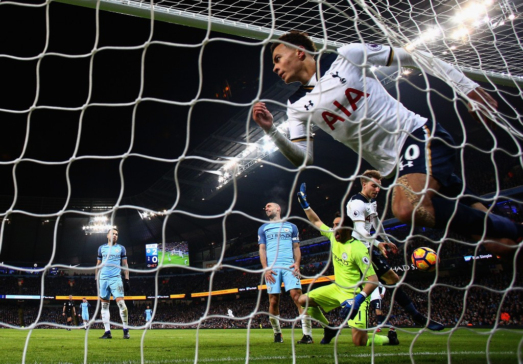 MANCHESTER, ENGLAND - JANUARY 21: Dele Alli of Tottenham Hotspur celebrates scoring his sides first goal during the Premier League match between Manchester City and Tottenham Hotspur at Etihad Stadium on January 21, 2017 in Manchester, England. (Photo by Clive Mason/Getty Images)