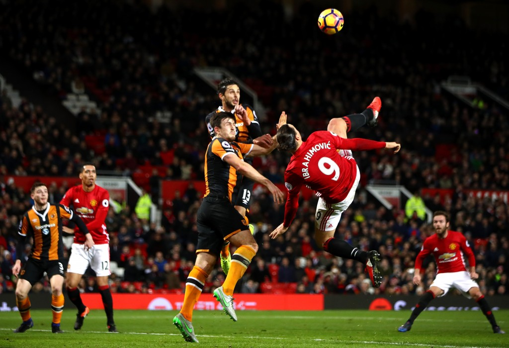 MANCHESTER, ENGLAND - FEBRUARY 01: Zlatan Ibrahimovic of Manchester United performs an acrobatic kick with Harry Maguire and Andrea Ranocchia of Hull City during the Premier League match between Manchester United and Hull City at Old Trafford on February 1, 2017 in Manchester, England. (Photo by Clive Mason/Getty Images)