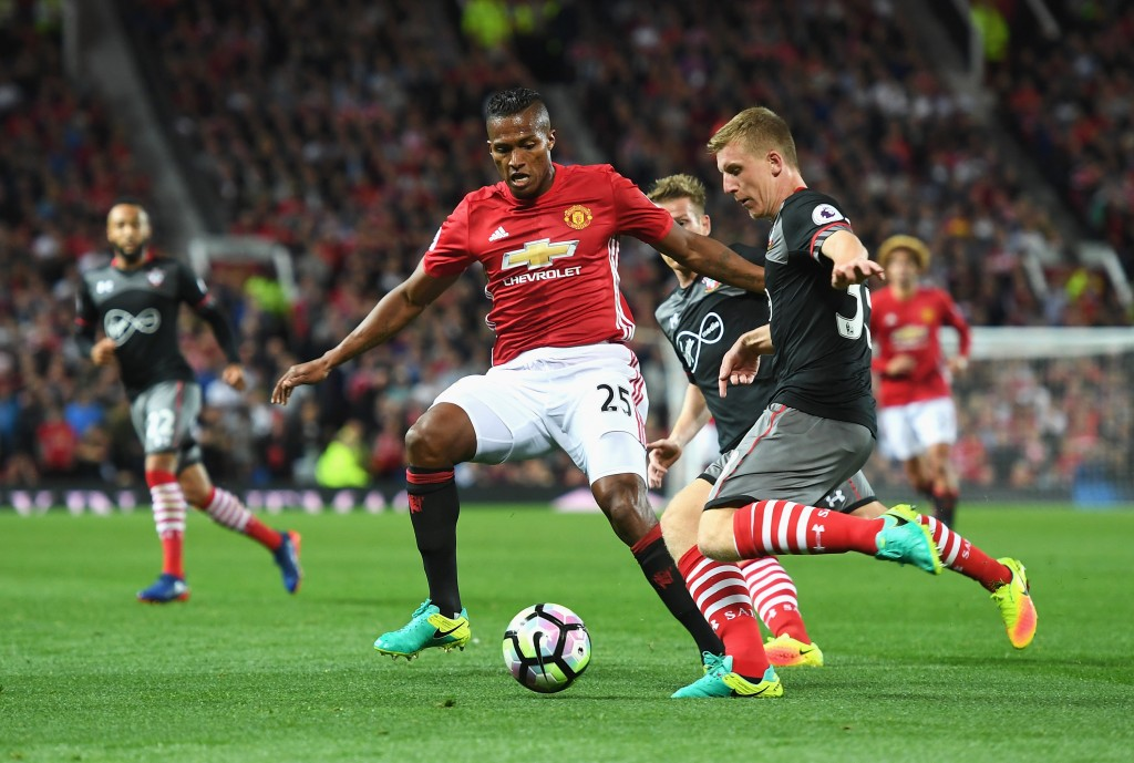 MANCHESTER, ENGLAND - AUGUST 19: Antonio Valencia of Manchester United closes down Matt Targett of Southampton during the Premier League match between Manchester United and Southampton at Old Trafford on August 19, 2016 in Manchester, England. (Photo by Michael Regan/Getty Images)