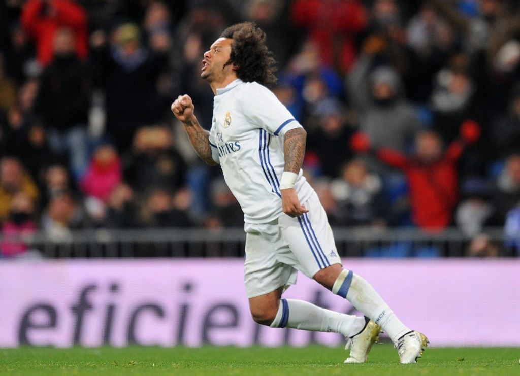 MADRID, SPAIN - JANUARY 18: Marcelo of Real Madrid reacts after scoring his team's 1st goal during the Copa del Rey Quarter Final, First Leg match between Real Madrid CF and Celta Vigo at Bernabeu on January 18, 2017 in Madrid, Spain. (Photo by Denis Doyle/Getty Images)
