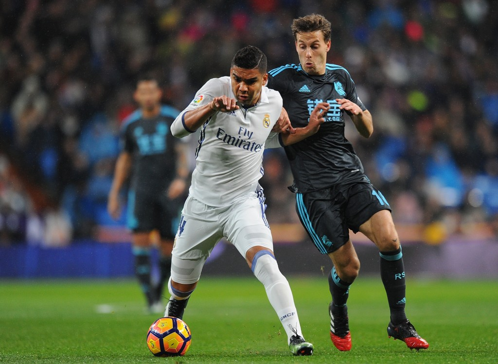 MADRID, SPAIN - JANUARY 29: Henrique Casemiro of Real Madrid is tackled by Sergio Canales of Real Sociedad de Futbol during the La Liga match between Real Madrid CF and Real Sociedad de Futbol at the Bernabeu on January 29, 2017 in Madrid, Spain. (Photo by Denis Doyle/Getty Images)
