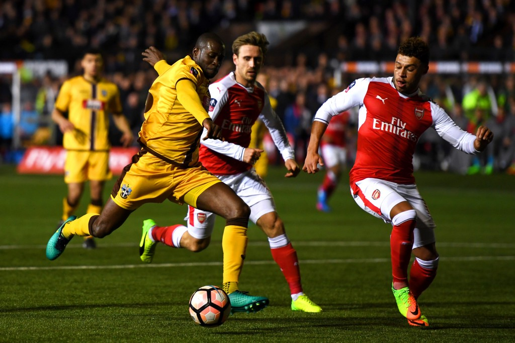SUTTON, GREATER LONDON - FEBRUARY 20: Alex Oxlade-Chamberlain of Arsenal blocks at shot on goal from Bedsente Gomis of Sutton United during the Emirates FA Cup fifth round match between Sutton United and Arsenal on February 20, 2017 in Sutton, Greater London. (Photo by Mike Hewitt/Getty Images)