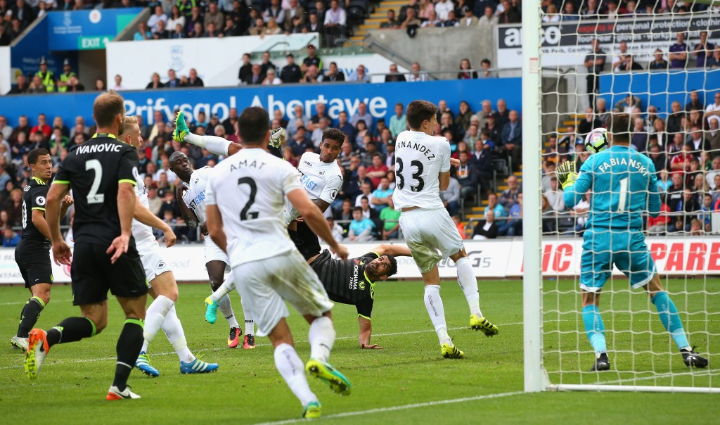 SWANSEA, WALES - SEPTEMBER 11: Diego Costa of Chelsea (C) scores their second goal during the Premier League match between Swansea City and Chelsea at Liberty Stadium on September 11, 2016 in Swansea, Wales. (Photo by Alex Livesey/Getty Images)