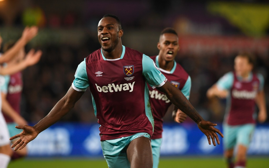 SWANSEA, WALES - DECEMBER 26: Michail Antonio of West Ham United celebrates scoring his team's third goal during the Premier League match between Swansea City and West Ham United at Liberty Stadium on December 26, 2016 in Swansea, Wales. (Photo by Stu Forster/Getty Images)