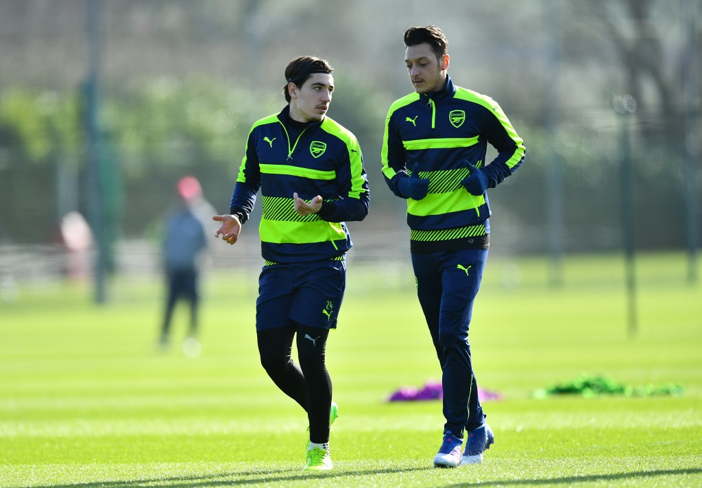 ST ALBANS, ENGLAND - MARCH 06: Hector Bellerin (L) and Mesut Oezul of Arsenal warm up during a training session at London Colney on March 6, 2017 in St Albans, England. (Photo by Dan Mullan/Getty Images)
