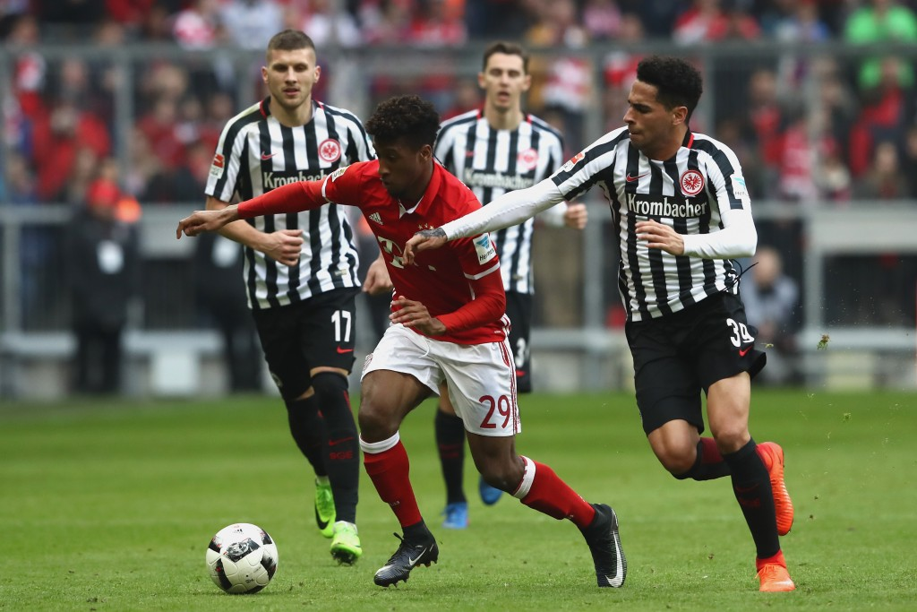 MUNICH, GERMANY - MARCH 11: Omar Mascarell (R) of Frankfurt battles for the ball with Kingsley Coman (C) of Muenchen during the Bundesliga match between Bayern Muenchen and Eintracht Frankfurt at Allianz Arena on March 11, 2017 in Munich, Germany. (Photo by Alexander Hassenstein/Bongarts/Getty Images)