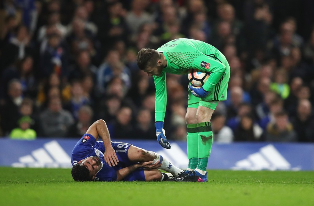 LONDON, ENGLAND - MARCH 13: David De Gea of Manchester United stands over an injured Diego Costa of Chelsea during The Emirates FA Cup Quarter-Final match between Chelsea and Manchester United at Stamford Bridge on March 13, 2017 in London, England. (Photo by Julian Finney/Getty Images)