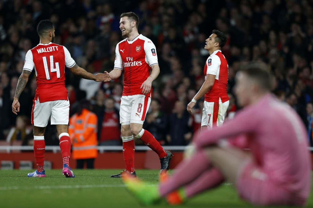 Arsenal's Welsh midfielder Aaron Ramsey (2nd L) celebrates with Arsenal's English midfielder Theo Walcott (L) after scoring their fifth goal during the English FA cup quarter final football match between Arsenal and Lincoln City at The Emirates Stadium in London on March 11, 2017. / AFP PHOTO / Ian KINGTON / RESTRICTED TO EDITORIAL USE. No use with unauthorized audio, video, data, fixture lists, club/league logos or 'live' services. Online in-match use limited to 75 images, no video emulation. No use in betting, games or single club/league/player publications. / (Photo credit should read IAN KINGTON/AFP/Getty Images)