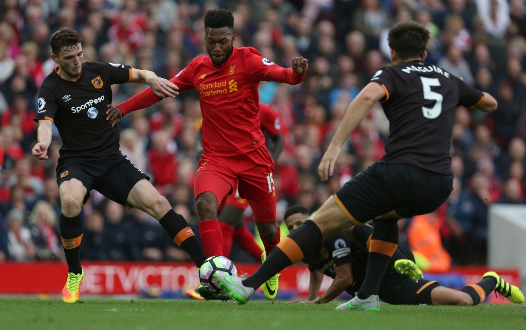 Liverpool's English striker Daniel Sturridge (C) vies with Hull City's Scottish defender Andrew Robertson (L) and Hull City's English defender Harry Maguire during the English Premier League football match between Liverpool and Hull City at Anfield in Liverpool, north west England on September 24, 2016. / AFP / Geoff CADDICK / RESTRICTED TO EDITORIAL USE. No use with unauthorized audio, video, data, fixture lists, club/league logos or 'live' services. Online in-match use limited to 75 images, no video emulation. No use in betting, games or single club/league/player publications. / (Photo credit should read GEOFF CADDICK/AFP/Getty Images)