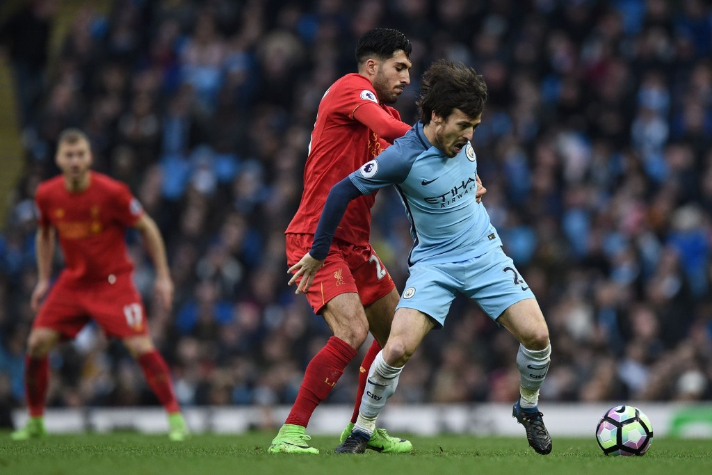 Liverpool's German midfielder Emre Can (2nd L) vies with Manchester City's Spanish midfielder David Silva during the English Premier League football match between Manchester City and Liverpool at the Etihad Stadium in Manchester, north west England, on March 19, 2017. / AFP PHOTO / Oli SCARFF / RESTRICTED TO EDITORIAL USE. No use with unauthorized audio, video, data, fixture lists, club/league logos or 'live' services. Online in-match use limited to 75 images, no video emulation. No use in betting, games or single club/league/player publications. / (Photo credit should read OLI SCARFF/AFP/Getty Images)