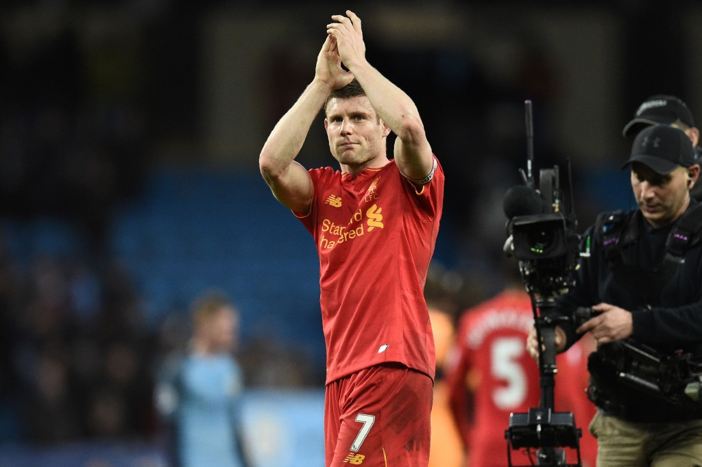 Liverpool's English midfielder James Milner applauds supporters on the pitch after the English Premier League football match between Manchester City and Liverpool at the Etihad Stadium in Manchester, north west England, on March 19, 2017. The game finished 1-1. / AFP PHOTO / Oli SCARFF / RESTRICTED TO EDITORIAL USE. No use with unauthorized audio, video, data, fixture lists, club/league logos or 'live' services. Online in-match use limited to 75 images, no video emulation. No use in betting, games or single club/league/player publications. / (Photo credit should read OLI SCARFF/AFP/Getty Images)