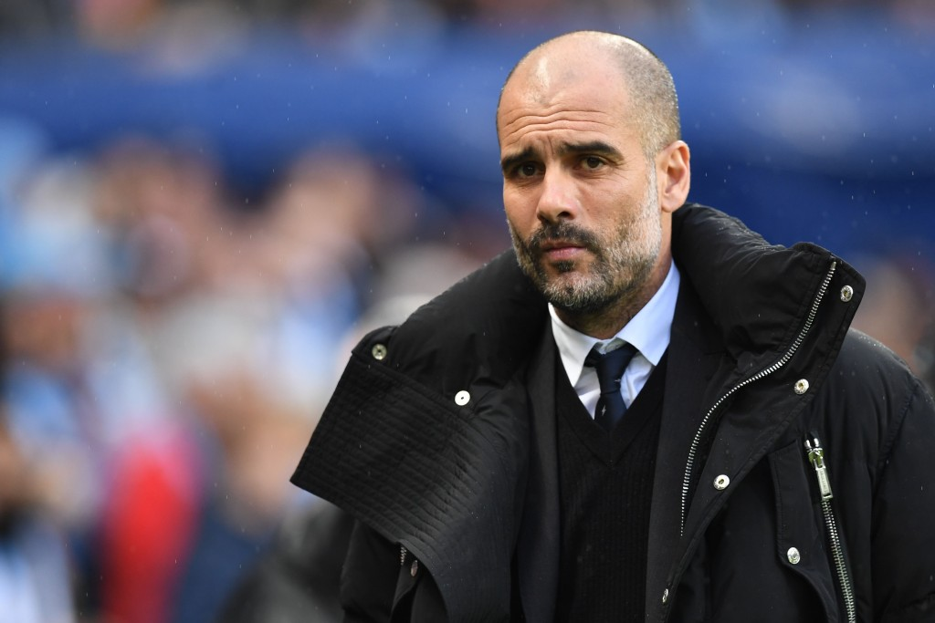 Manchester City's Spanish manager Pep Guardiola looks on before the English Premier League football match between Manchester City and Liverpool at the Etihad Stadium in Manchester, north west England, on March 19, 2017. / AFP PHOTO / Paul ELLIS / RESTRICTED TO EDITORIAL USE. No use with unauthorized audio, video, data, fixture lists, club/league logos or 'live' services. Online in-match use limited to 75 images, no video emulation. No use in betting, games or single club/league/player publications. / (Photo credit should read PAUL ELLIS/AFP/Getty Images)