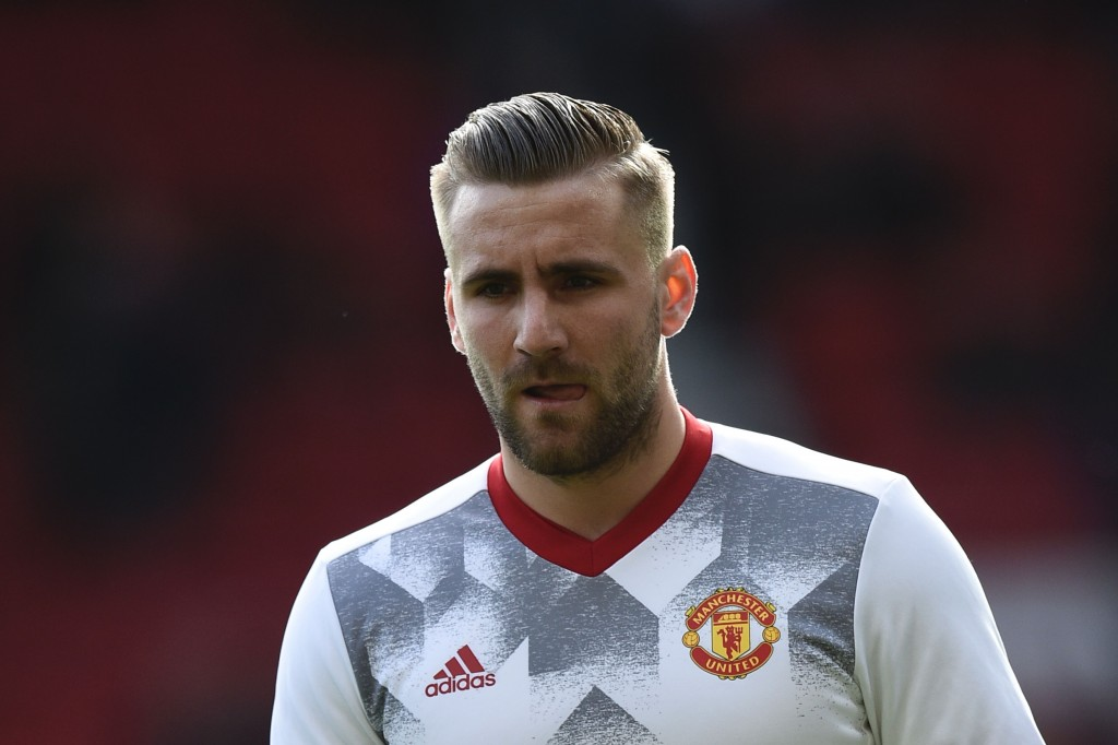 Manchester United's English defender Luke Shaw warms up before the English Premier League football match between Manchester United and Bournemouth at Old Trafford in Manchester, north west England, on March 4, 2017. / AFP PHOTO / Oli SCARFF / RESTRICTED TO EDITORIAL USE. No use with unauthorized audio, video, data, fixture lists, club/league logos or 'live' services. Online in-match use limited to 75 images, no video emulation. No use in betting, games or single club/league/player publications. / (Photo credit should read OLI SCARFF/AFP/Getty Images)