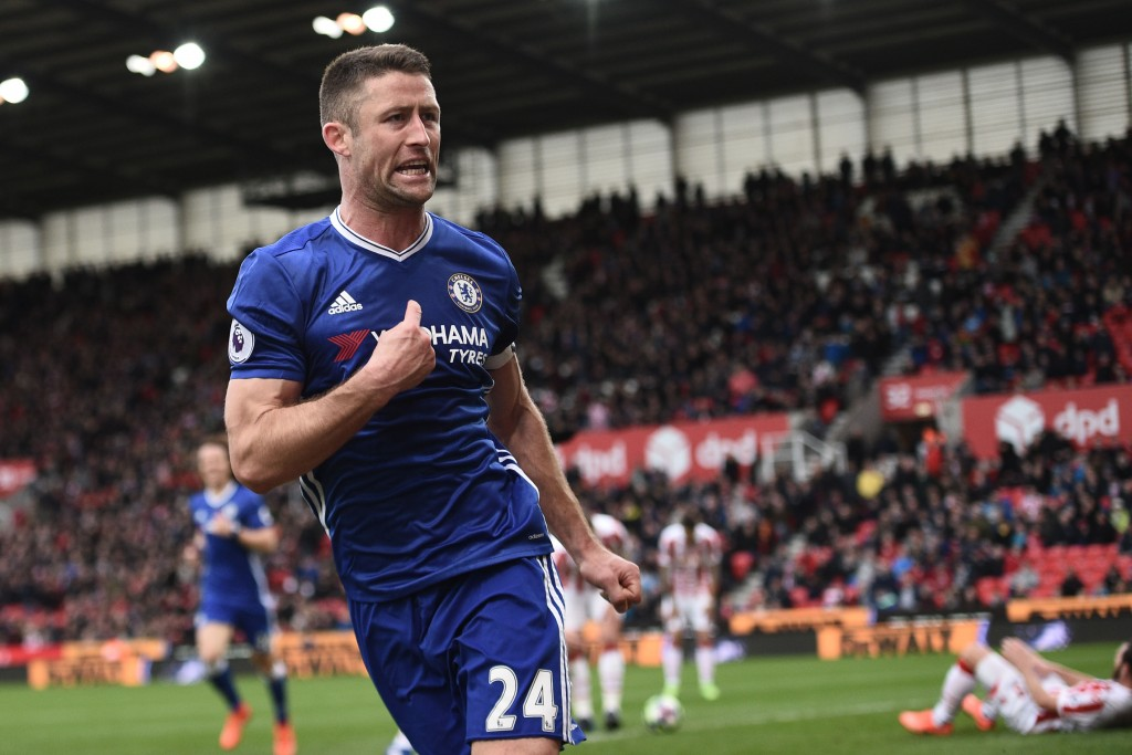 Chelsea's English defender Gary Cahill (C) celebrates after scoring their second goal during the English Premier League football match between Stoke City and Chelsea at the Bet365 Stadium in Stoke-on-Trent, central England on March 18, 2017. / AFP PHOTO / Oli SCARFF / RESTRICTED TO EDITORIAL USE. No use with unauthorized audio, video, data, fixture lists, club/league logos or 'live' services. Online in-match use limited to 75 images, no video emulation. No use in betting, games or single club/league/player publications. / (Photo credit should read OLI SCARFF/AFP/Getty Images)