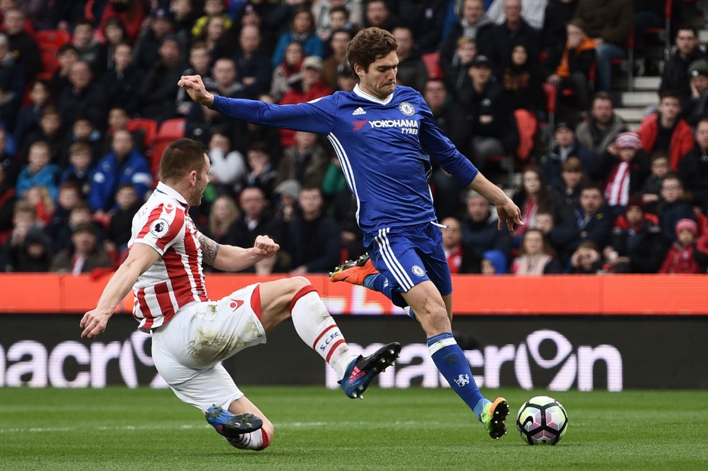 Stoke City's English-born Scottish defender Phil Bardsley (L) tries to block a shot by Chelsea's Spanish defender Marcos Alonso during the English Premier League football match between Stoke City and Chelsea at the Bet365 Stadium in Stoke-on-Trent, central England on March 18, 2017. / AFP PHOTO / Oli SCARFF / RESTRICTED TO EDITORIAL USE. No use with unauthorized audio, video, data, fixture lists, club/league logos or 'live' services. Online in-match use limited to 75 images, no video emulation. No use in betting, games or single club/league/player publications. / (Photo credit should read OLI SCARFF/AFP/Getty Images)