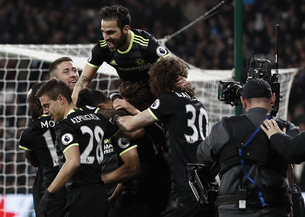 A television (TV) camera operater films as Chelsea's Brazilian-born Spanish striker Diego Costa celebrates scoring his team's second goal during the English Premier League football match between West Ham United and Cheslsea at The London Stadium in east London on March 6, 2017. / AFP PHOTO / Adrian DENNIS / RESTRICTED TO EDITORIAL USE. No use with unauthorized audio, video, data, fixture lists, club/league logos or 'live' services. Online in-match use limited to 75 images, no video emulation. No use in betting, games or single club/league/player publications. / (Photo credit should read ADRIAN DENNIS/AFP/Getty Images)