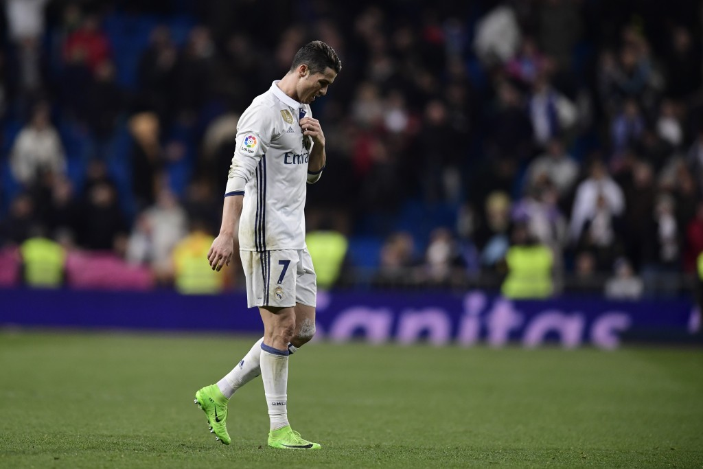 Real Madrid's Portuguese forward Cristiano Ronaldo leaves the pitch at the end of the Spanish league football match Real Madrid CF vs UD Las Palmas at the Santiago Bernabeu stadium in Madrid on March 1, 2017. / AFP PHOTO / JAVIER SORIANO (Photo credit should read JAVIER SORIANO/AFP/Getty Images)