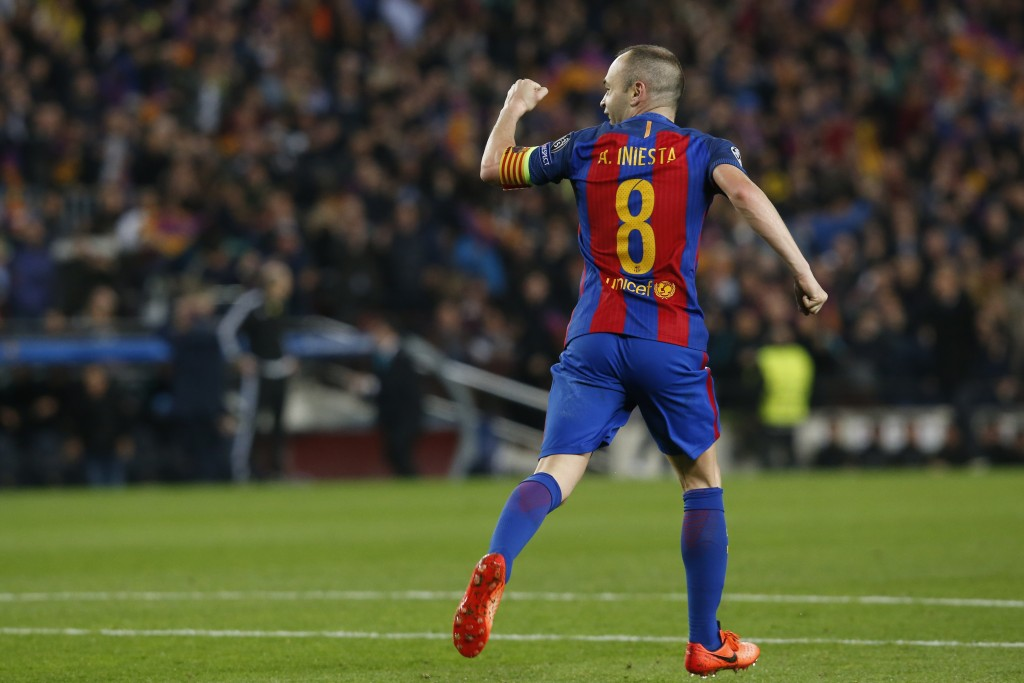 Barcelona's midfielder Andres Iniesta celebrates Paris Saint-Germain's own goal during the UEFA Champions League round of 16 second leg football match FC Barcelona vs Paris Saint-Germain FC at the Camp Nou stadium in Barcelona on March 8, 2017. / AFP PHOTO / PAU BARRENA (Photo credit should read PAU BARRENA/AFP/Getty Images)
