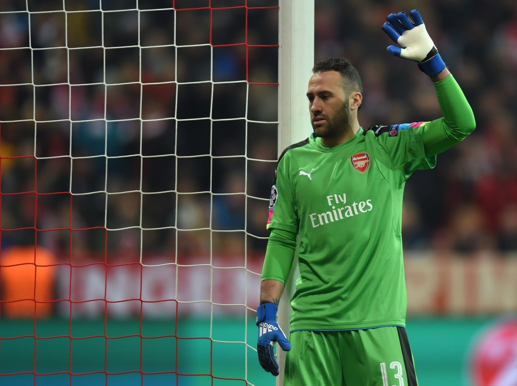 ArsenalÕs Colombian goalkeeper David Ospina gestures during the UEFA Champions League round of sixteen football match between FC Bayern Munich and Arsenal in Munich, southern Germany, on February 15, 2017. / AFP / Christof STACHE (Photo credit should read CHRISTOF STACHE/AFP/Getty Images)