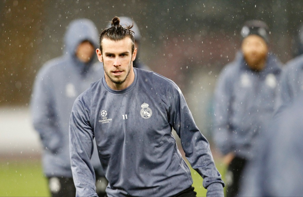 Real Madrid's Welsh forward Gareth Bale attends a training session under heavy rain on the eve of the Champions League football match Napoli vs Real Madrid on March 6, 2017 at the San Paolo stadium in Naples. / AFP PHOTO / CARLO HERMANN (Photo credit should read CARLO HERMANN/AFP/Getty Images)