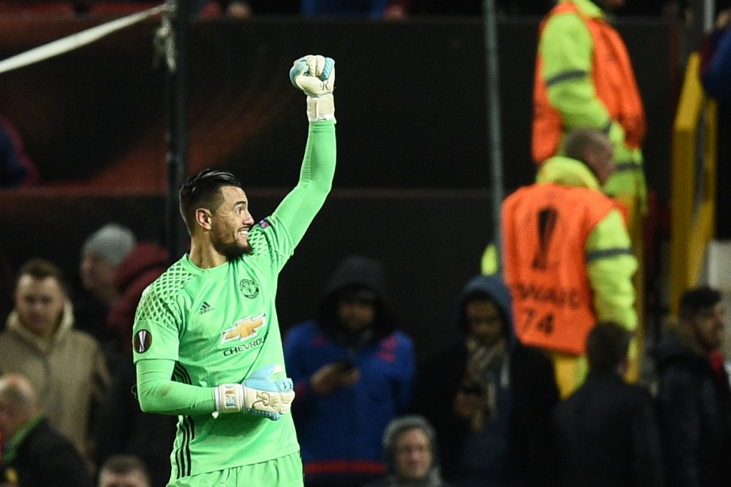 Manchester United's Argentinian goalkeeper Sergio Romero celebrates at the final whistle during the UEFA Europa League round of 16 second-leg football match between Manchester United and FC Rostov at Old Trafford stadium in Manchester, north-west England, on March 16, 2017. / AFP PHOTO / Oli SCARFF (Photo credit should read OLI SCARFF/AFP/Getty Images)