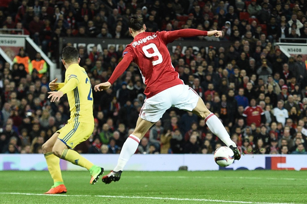 Manchester United's Swedish striker Zlatan Ibrahimovic (R) does a backward flick to lay the ball off for Manchester United's Spanish midfielder Juan Mata (unseen) to score the opening goal during the UEFA Europa League round of 16 second-leg football match between Manchester United and FC Rostov at Old Trafford stadium in Manchester, north-west England, on March 16, 2017. / AFP PHOTO / Oli SCARFF (Photo credit should read OLI SCARFF/AFP/Getty Images)