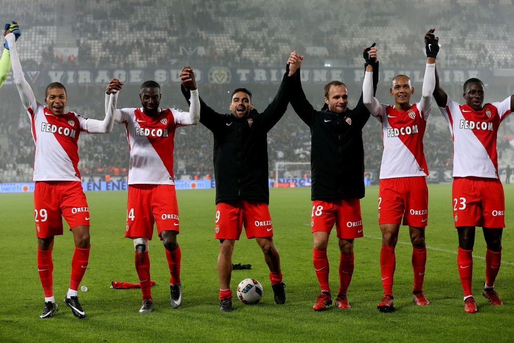 (L to R) Monaco's French forward Kylian Mbappe, Monaco's French midfielder Tiemoue Bakayoko, Monaco's Colombian forward Radamel Falcao, Monaco's French forward Valere Germain, Monaco's Brazilian defender Fabinho and Monaco's French defender Benjamin Mendy celebrate at the end of the French L1 football match Bordeaux vs Monaco on December 10, 2013 at the Matmut Atlantique Stadium in Bordeaux. / AFP / ROMAIN PERROCHEAU (Photo credit should read ROMAIN PERROCHEAU/AFP/Getty Images)