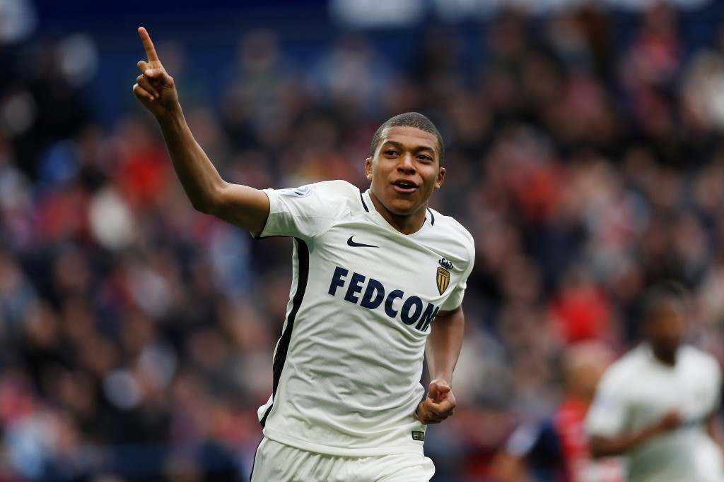 Monaco's French forward Kylian Mbappe Lottin celebrates after scoring a goal during the French L1 football match between Caen (SMC) and Monaco (AS), on March 19, 2017 at the Michel d'Ornano stadium, in Caen, northwestern France. / AFP PHOTO / CHARLY TRIBALLEAU (Photo credit should read CHARLY TRIBALLEAU/AFP/Getty Images)