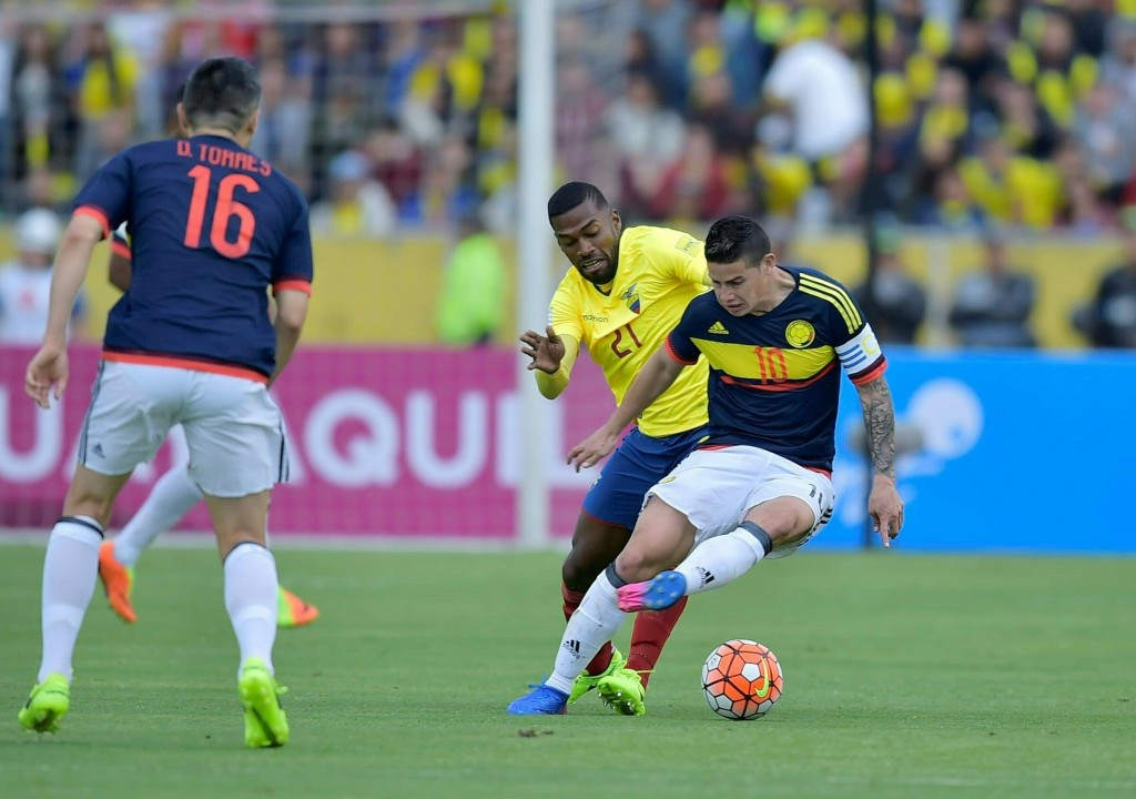 Colombia's midfielder James Rodriguez (R) vies for the ball with Ecuador's defender Gabriel Achilier during their 2018 FIFA World Cup qualifier football match in Quito, on March 28, 2017. / AFP PHOTO / Rodrigo BUENDIA (Photo credit should read RODRIGO BUENDIA/AFP/Getty Images)