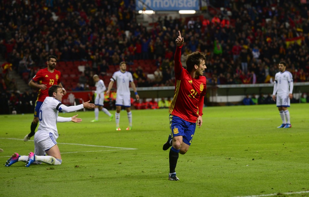 Spain's midfielder David Silva celebrates after scoring a goal during the WC 2018 group G football qualifing match Spain vs Israel at El Molinon stadium in Gijon on March 24, 2017. / AFP PHOTO / MIGUEL RIOPA (Photo credit should read MIGUEL RIOPA/AFP/Getty Images)