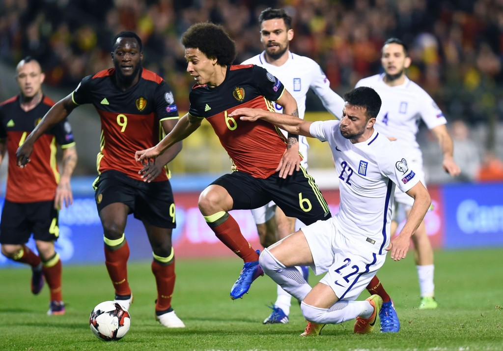 Belgium's midfielder Axel Witsel (C) vies with Greece's Andreas Samaris (R) during the FIFA World Cup 2018 qualification football match between Belgium and Greece, at the King Baudouin Stadium, on March 25, 2017 in Brussels. / AFP PHOTO / JOHN THYS (Photo credit should read JOHN THYS/AFP/Getty Images)