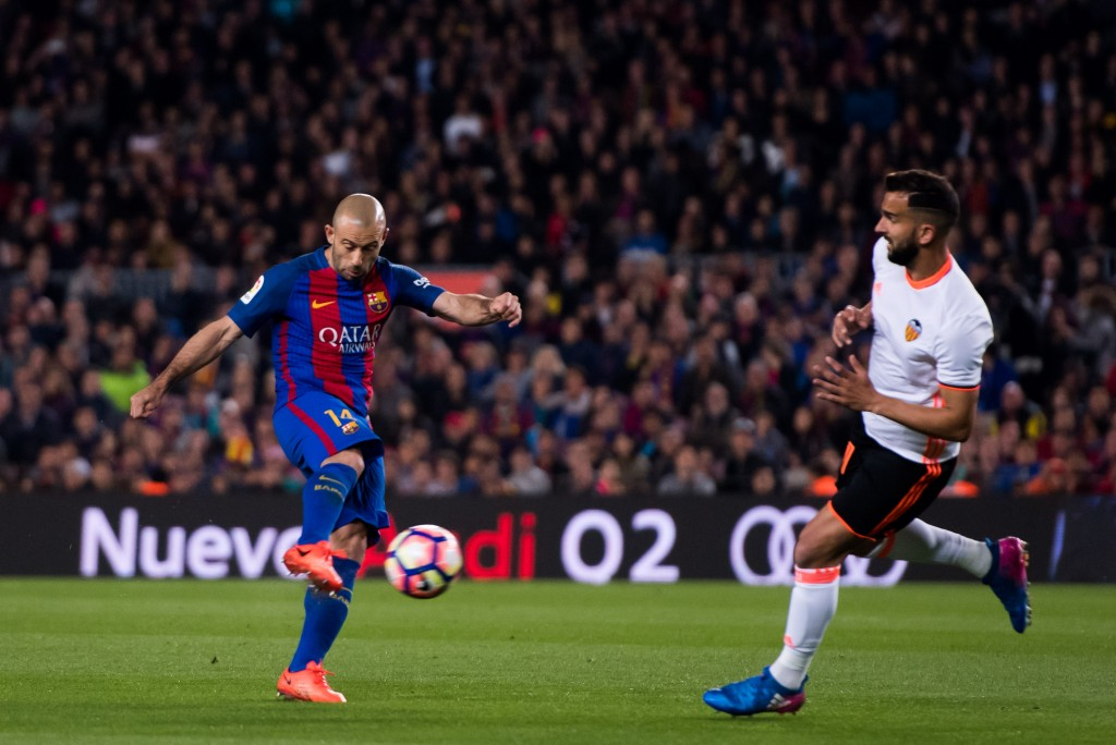 BARCELONA, SPAIN - MARCH 19: Javier Mascherano (L) of FC Barcelona shoots on goal next to Martin Montoya of Valencia CF during the La Liga match between FC Barcelona and Valencia CF at Camp Nou stadium on March 19, 2017 in Barcelona, Spain. (Photo by Alex Caparros/Getty Images)