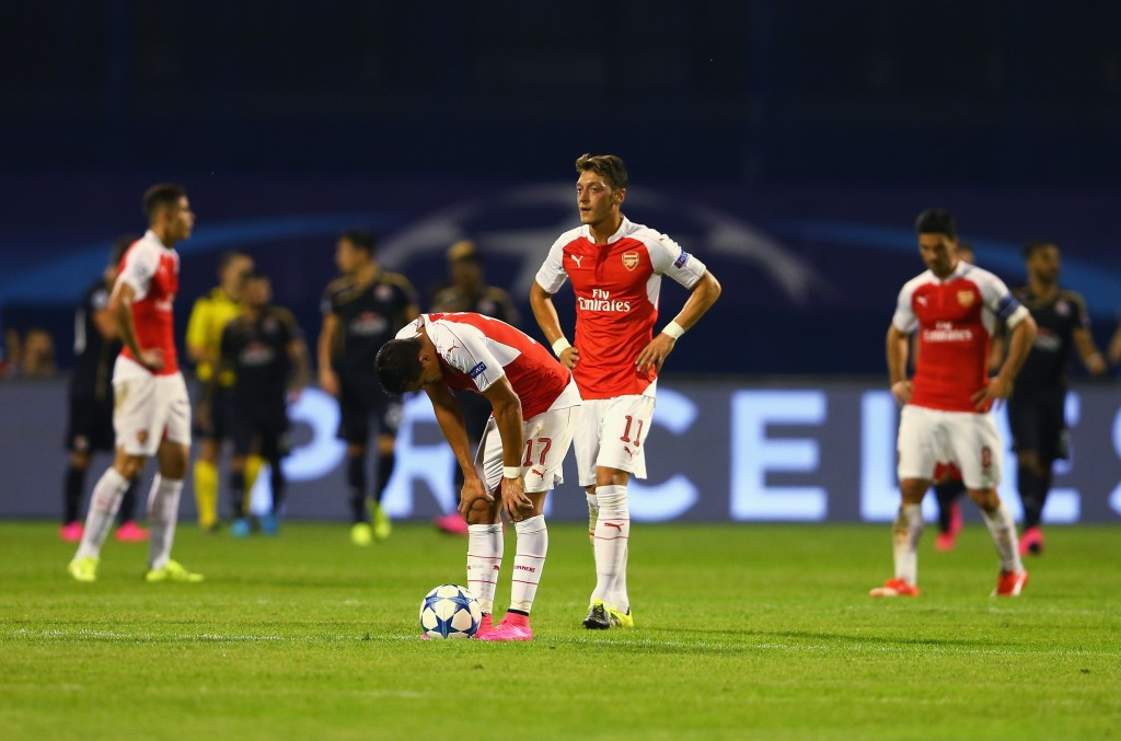 ZAGREB, CROATIA - SEPTEMBER 16: Alexis Sanchez and Mesut Oezil of Arsenal look dejected after the second Dinamo Zagreb goal during the UEFA Champions League Group F match between Dinamo Zagreb and Arsenal at Maksimir Stadium on September 16, 2015 in Zagreb, Croatia. (Photo by Alexander Hassenstein/Getty Images)