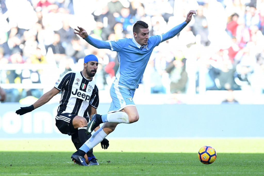 TURIN, ITALY - JANUARY 22: Sami Khedira (L) of Juventus FC tackles Sergej Milinkovic of SS Lazio during the Serie A match between Juventus FC and SS Lazio at Juventus Stadium on January 22, 2017 in Turin, Italy. (Photo by Valerio Pennicino/Getty Images)