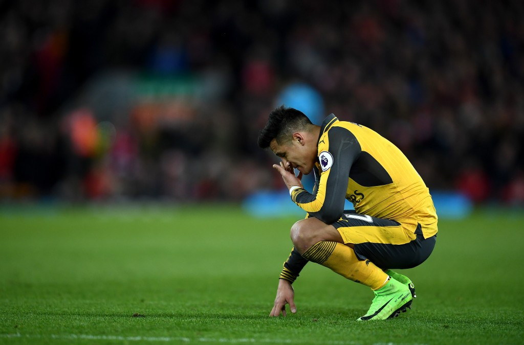 LIVERPOOL, ENGLAND - MARCH 04: Alexis Sanchez of Arsenal looks dejected during the Premier League match between Liverpool and Arsenal at Anfield on March 4, 2017 in Liverpool, England. (Photo by Laurence Griffiths/Getty Images)