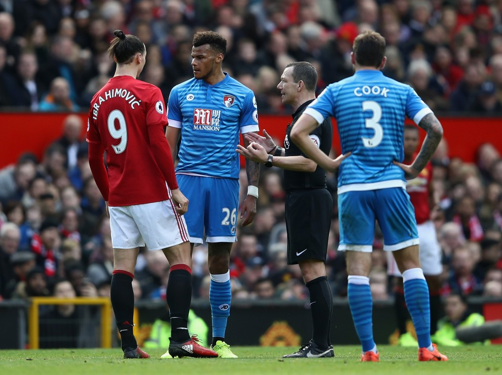 MANCHESTER, ENGLAND - MARCH 04: Tyrone Mings of Bournemouth and Zlatan Ibrahimovic of Manchester United clash during the Premier League match between Manchester United and AFC Bournemouth at Old Trafford on March 4, 2017 in Manchester, England. (Photo by Julian Finney/Getty Images)