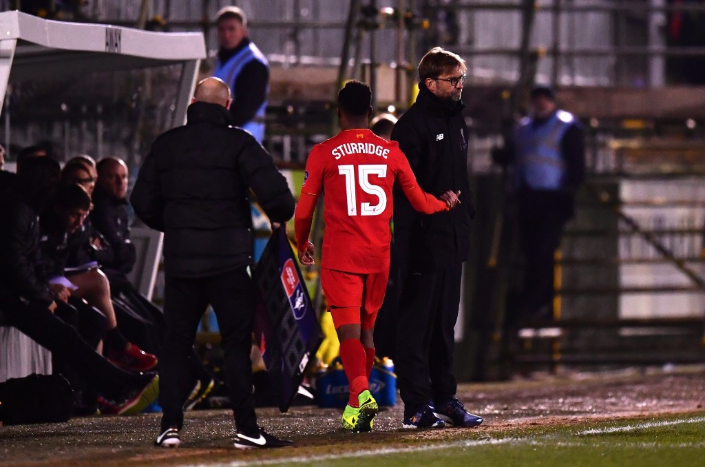 PLYMOUTH, ENGLAND - JANUARY 18: Jurgen Klopp, manager of Liverpool shakes hands with Daniel Sturridge of Liverpool as he is substituted during The Emirates FA Cup Third Round Replay match between Plymouth Argyle and Liverpool at Home Park on January 18, 2017 in Plymouth, England. (Photo by Dan Mullan/Getty Images)
