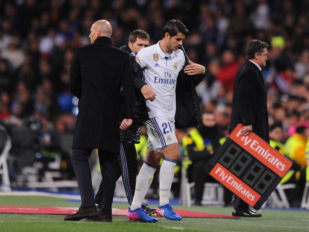 MADRID, SPAIN - MARCH 12: Alvaro Morata of Real Madrid walks past his head coach Zinedine Zidane after coming off during the La Liga match between Real Madrid CF and Real Betis Balompie at Estadio Santiago Bernabeu on March 12, 2017 in Madrid, Spain. (Photo by Denis Doyle/Getty Images)