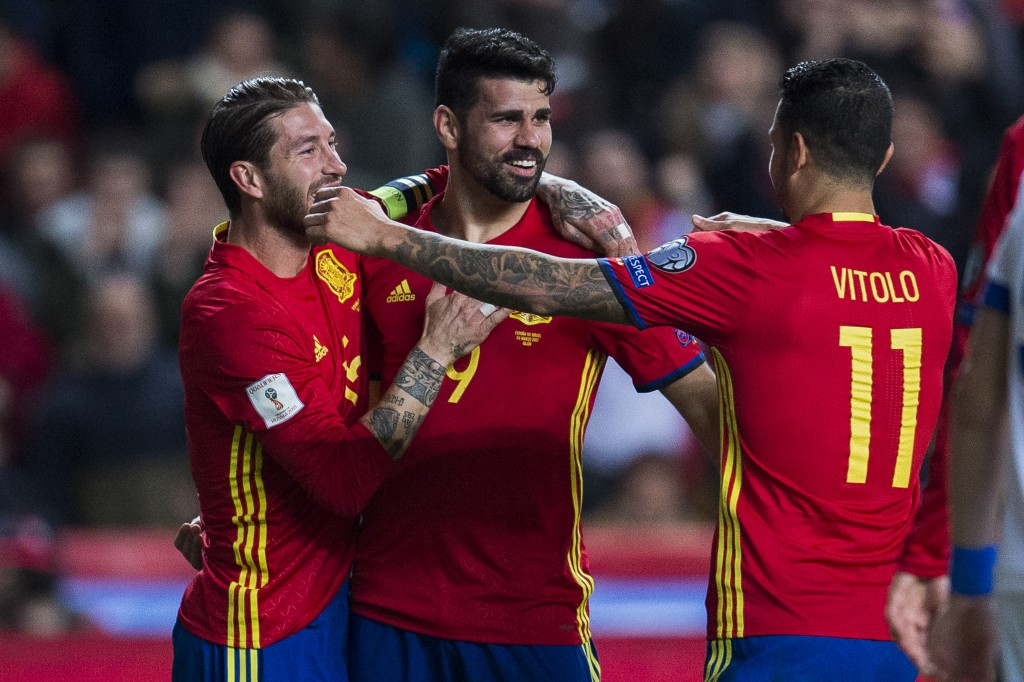 GIJON, SPAIN - MARCH 24: Diego Costa of Spain celebrates with his teammates Sergio Ramos and Victor Machin Perez 'Vitolo' of Spain after scoring his team's third goal during the FIFA 2018 World Cup Qualifier between Spain and Israel at Estadio El Molinon on March 24, 2017 in Gijon, Spain. (Photo by Juan Manuel Serrano Arce/Getty Images)