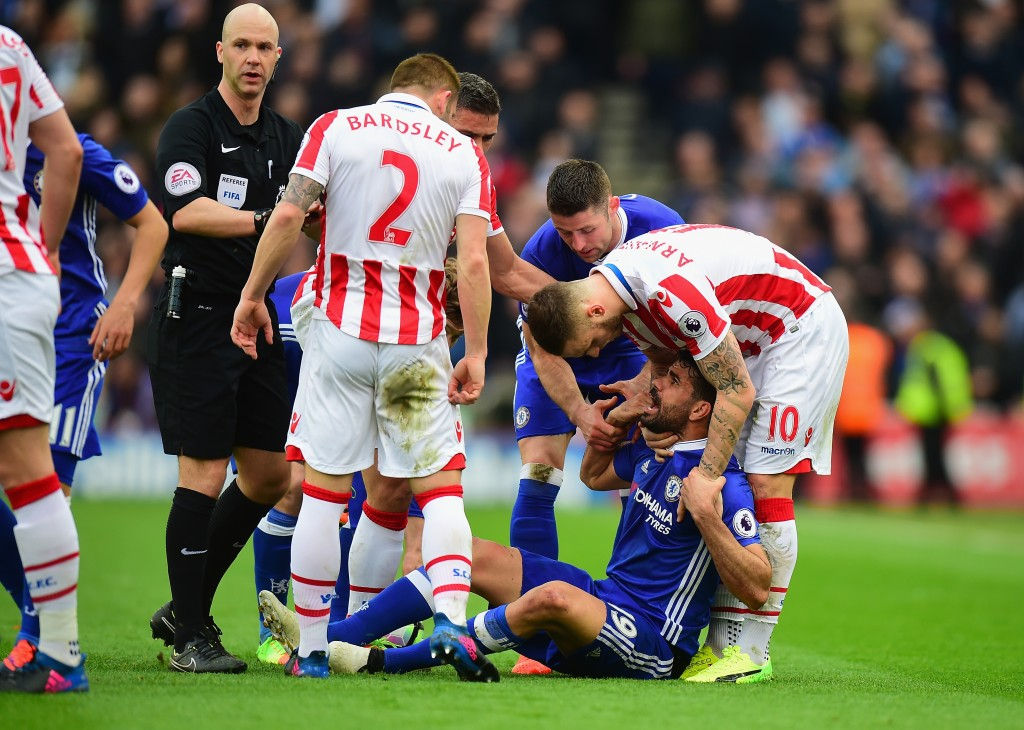 STOKE ON TRENT, ENGLAND - MARCH 18: Marko Arnautovic of Stoke City helps Diego Costa of Chelsea off the ground during the Premier League match between Stoke City and Chelsea at Bet365 Stadium on March 18, 2017 in Stoke on Trent, England. (Photo by Tony Marshall/Getty Images)